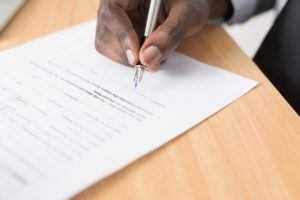 contractor - man signing contract
