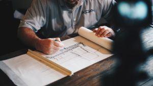 contractor - man working on blueprints