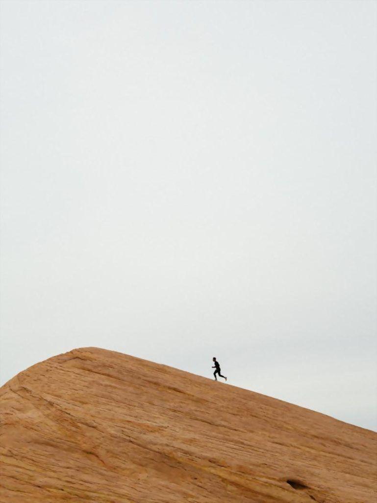 highlander - man running up rock