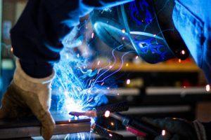 contractor - man welding steel beams